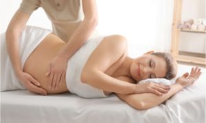 massaging pregnant woman